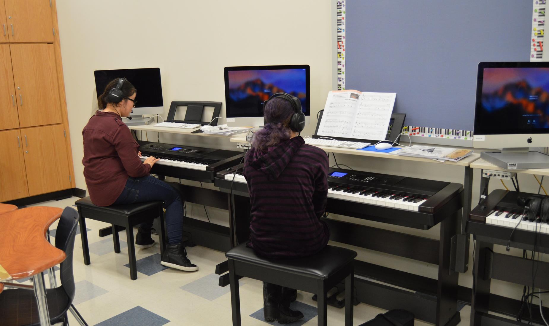 2 high school students sitting at the keyboard in the Bensalem High School Piano Lab