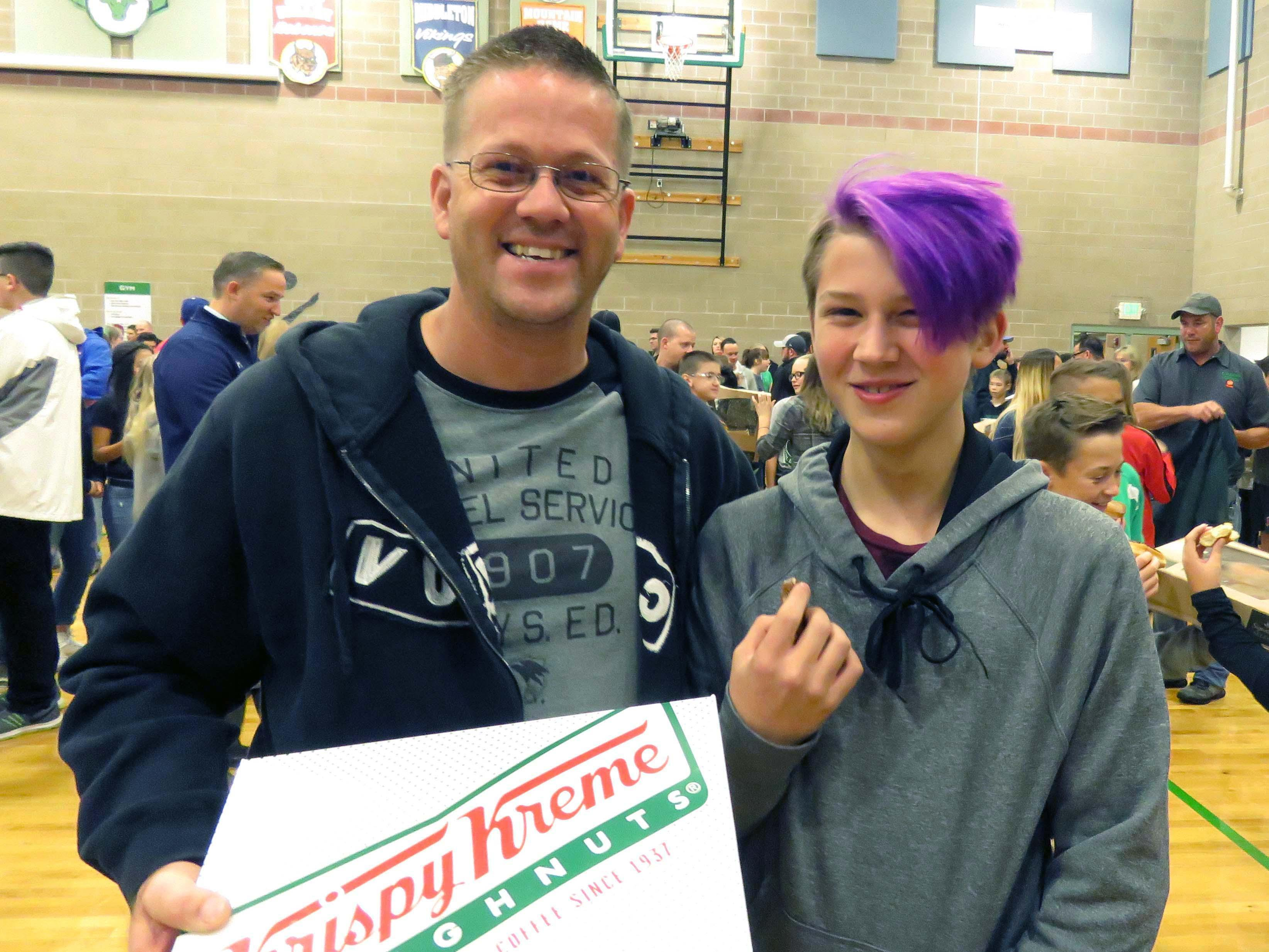 Dad and student at Dads and Donuts event