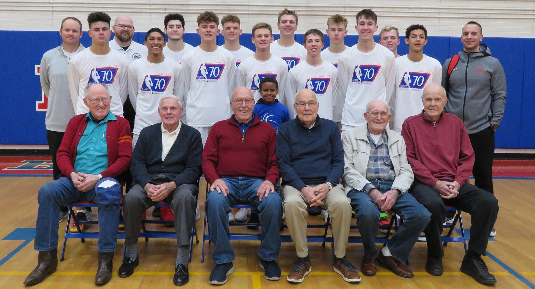 NHS basketball team pose with 1949 alumni.