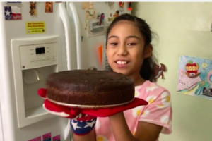 girl showing off finished cake
