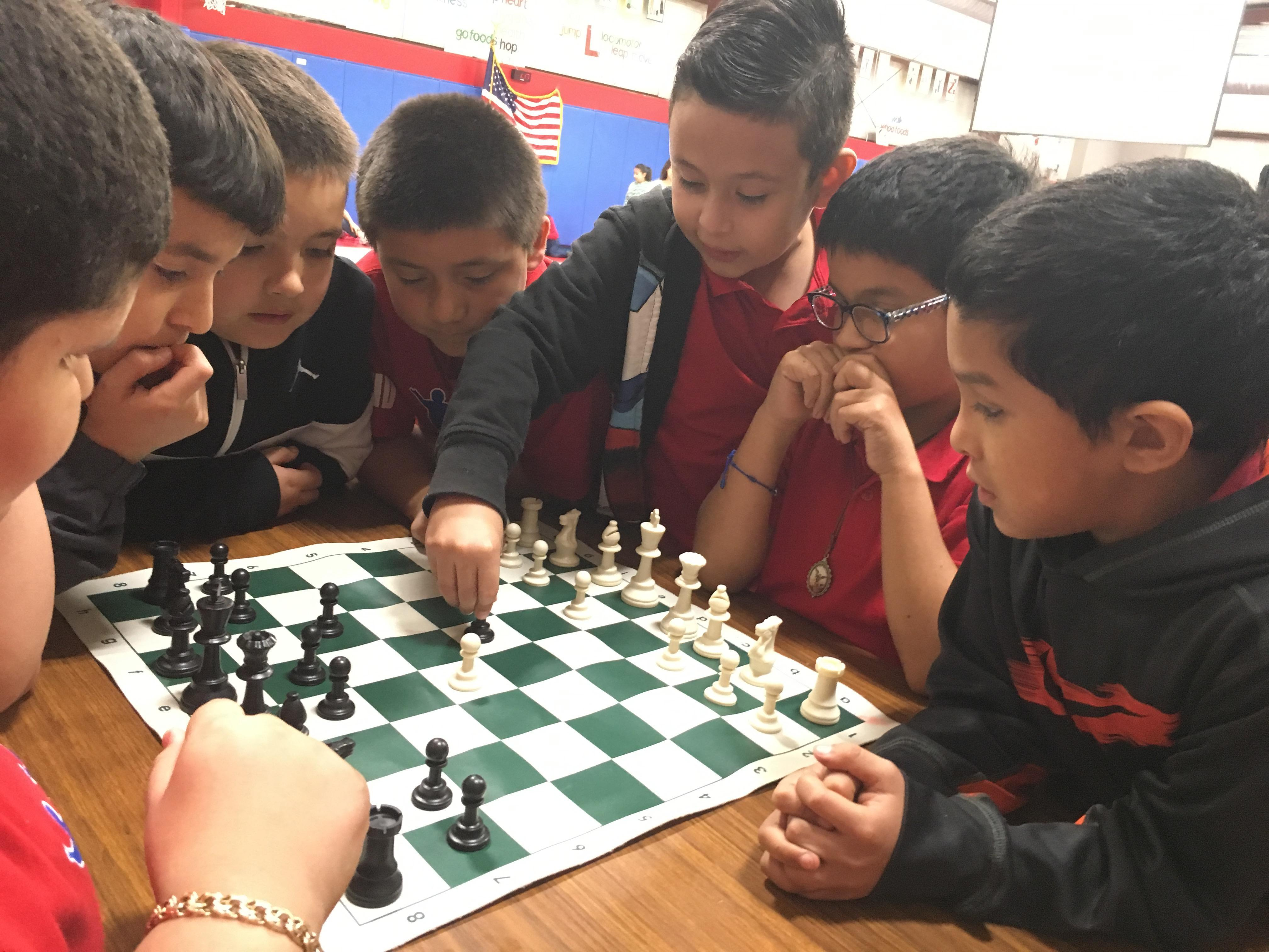 Students play chess.