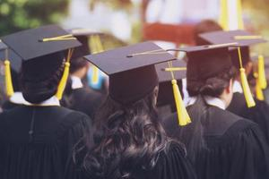 Image of students donning their cap and gowns.