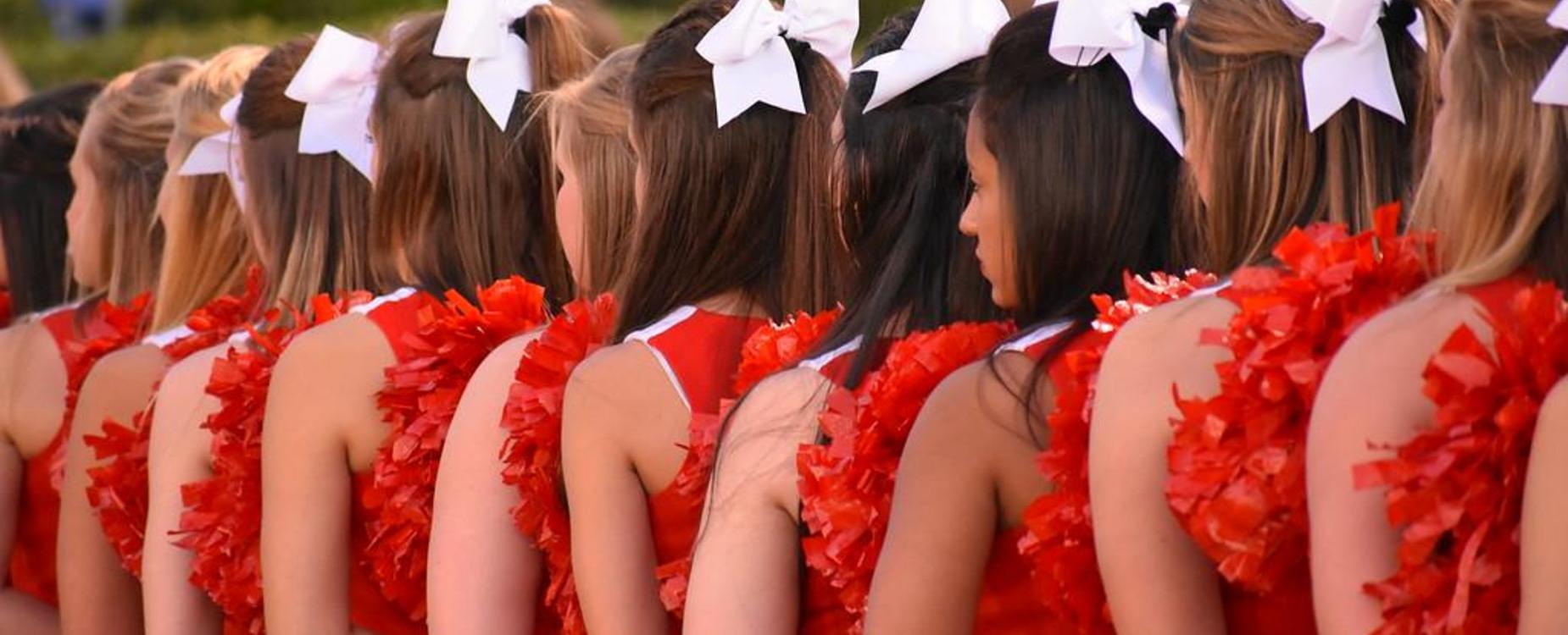 cheerleaders pledging flag