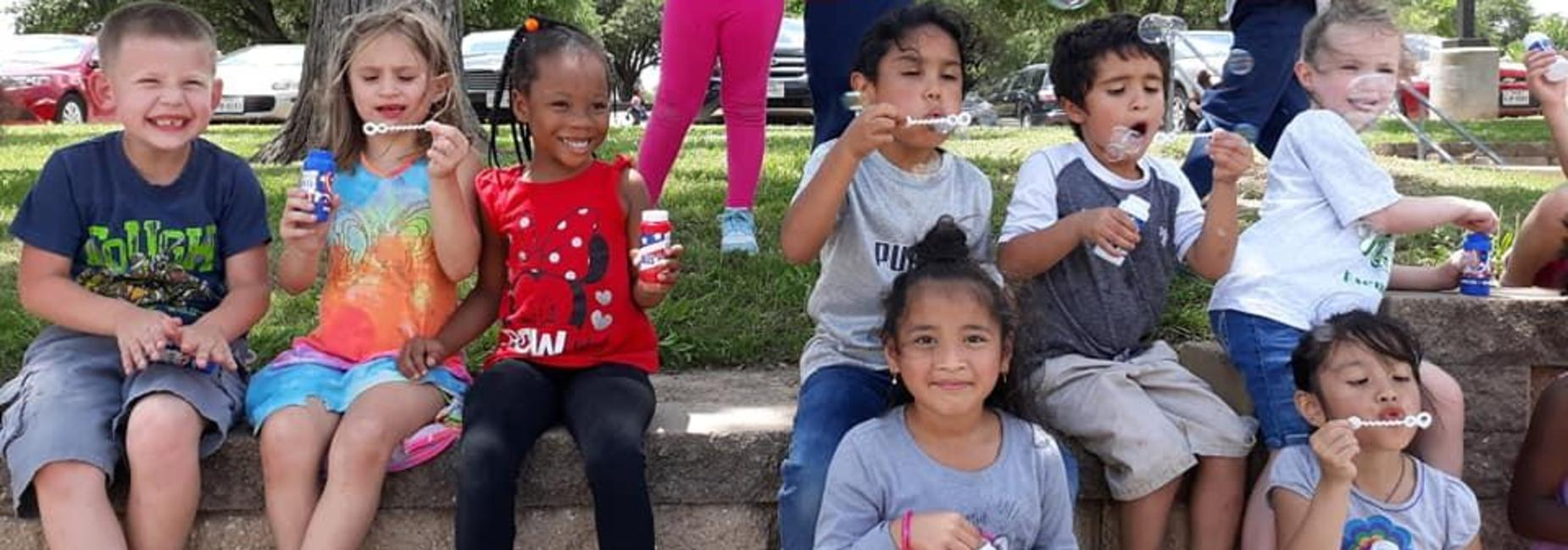 Kids enjoying snow-cones & bubbles
