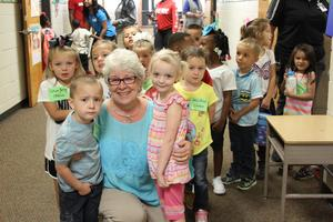 Teacher with students on first day of school