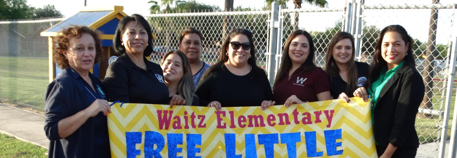 Waitz staff at Little Library ribbon cutting