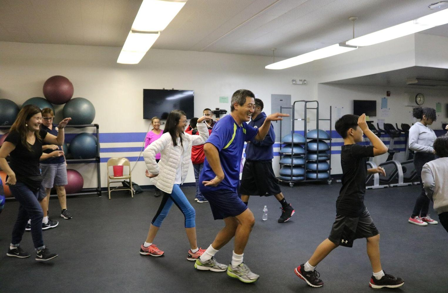 students and parents exercising