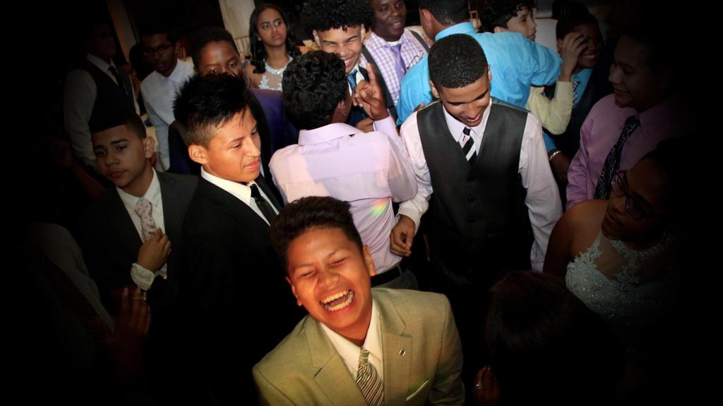 boy smiling in the middle of the dancefloor