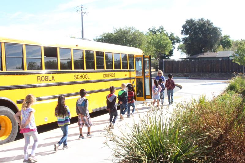 Students loading onto bus