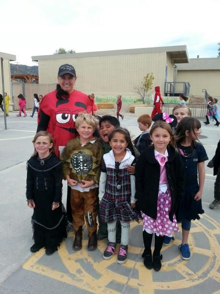 Teacher and students in Halloween costumes