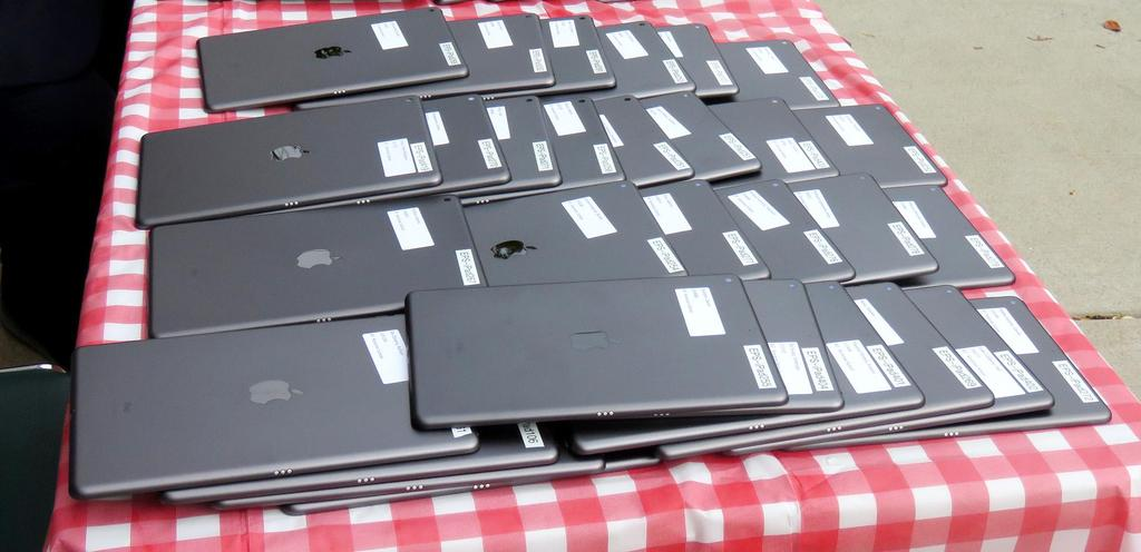 A table with iPads