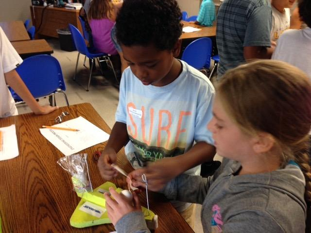 Students engaging in STEAM (Science, Technology, Engineering, Arts, Math)
