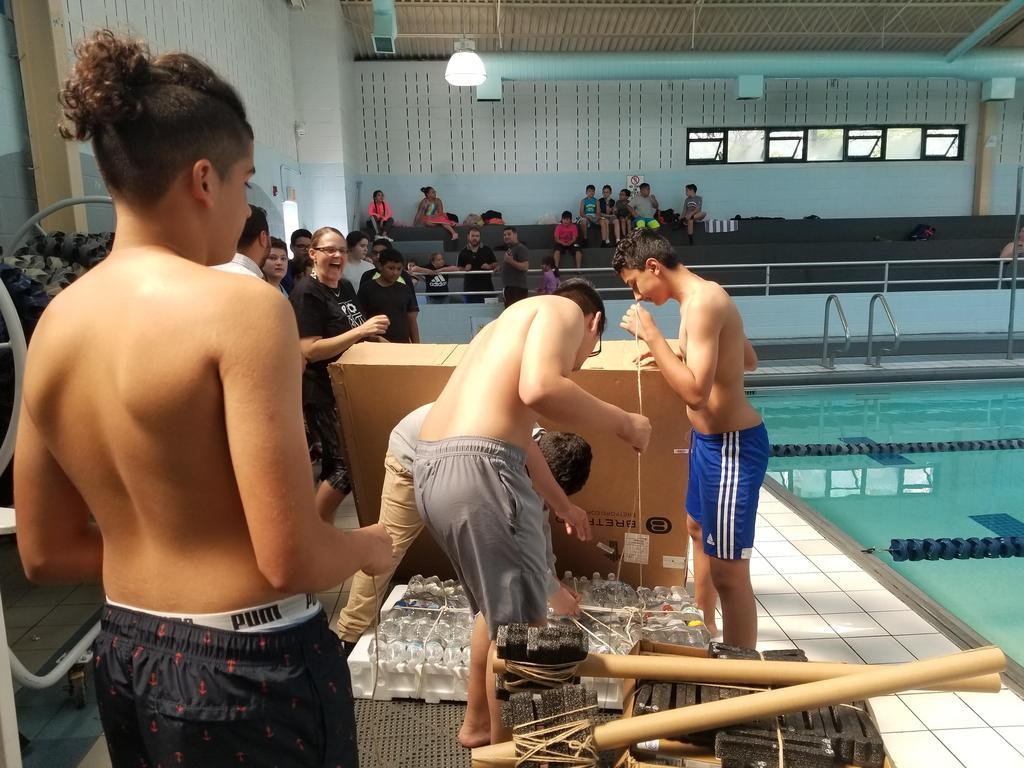 boys tying up the reggatta raft