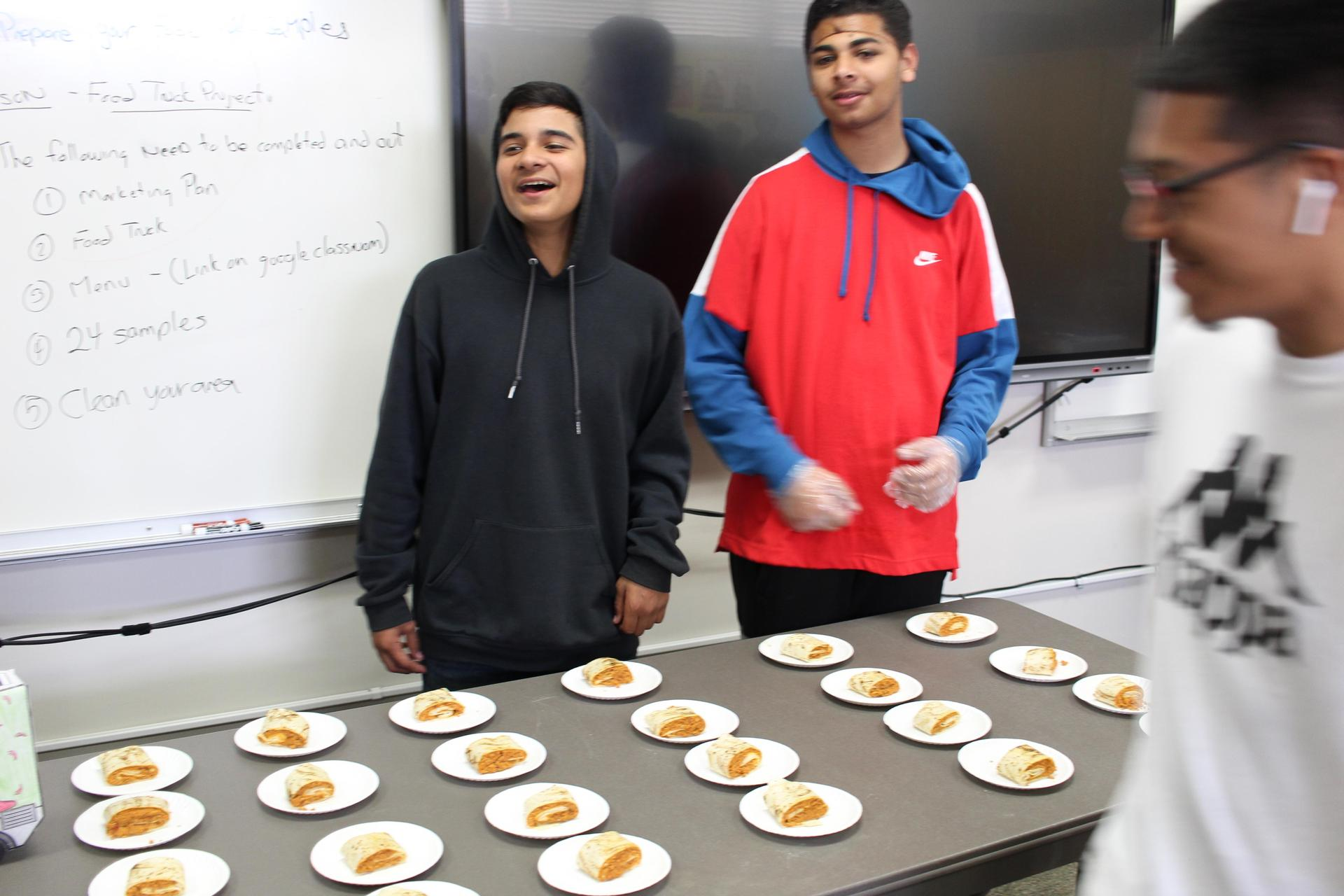 Culinary students presenting their food truck treats