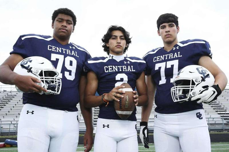 Central Catholic senior quarterback and Army commit Sylas Gomez, center, feels confident in the pocket behind tackles and fellow seniors Ben Rios, right, and Deandre Marshall, close friends who are committed to UTSA.