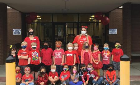 Ms. Leonard and Mrs. Nichols Wear Red with their Kindergarteners to Kick Off Red Ribbon Week!