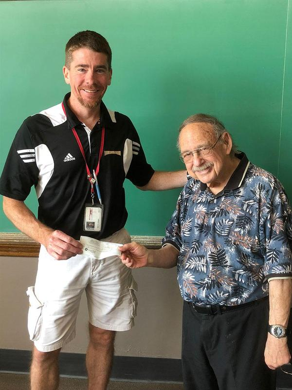 Principal Tim Kenney, left, with 1963 SHS Alumnus Larry Lapidus, right