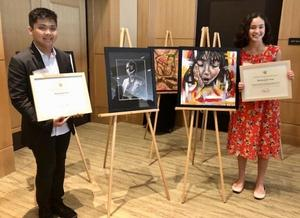 Vincent Tan and Madeleine Yoo with artwork