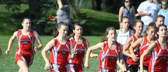 Cross Country team running at a meet.
