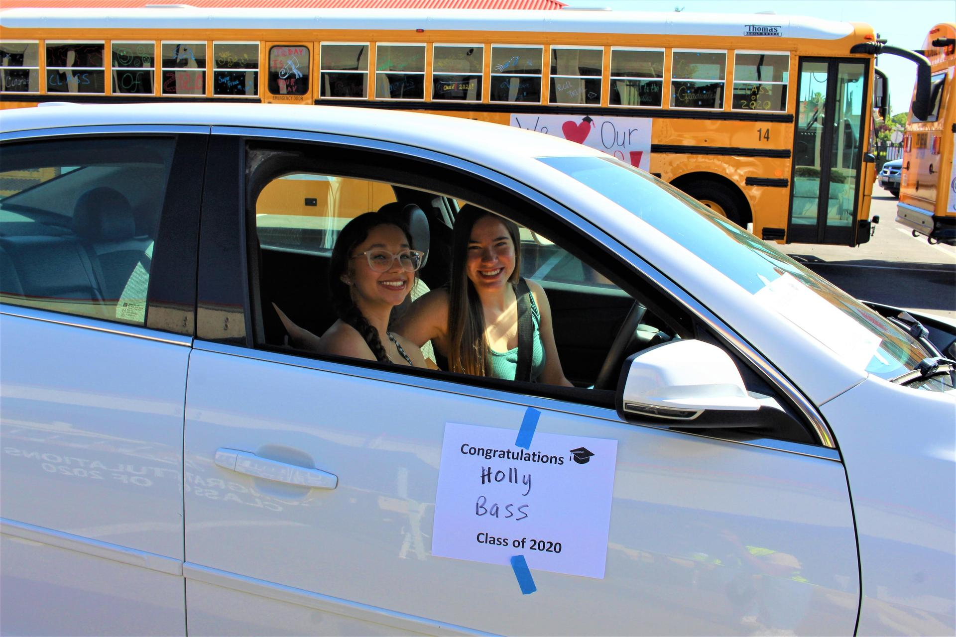 Holly Bass riding with Christina Fuller driving through