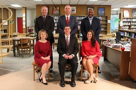 Picture of Mayfield Independent Schools Board members.  Seated are Martha Wynstra, Chris Green and Michelle Arnett.  Standing behind them are Joe Henderson, Matt Monroe and Larry Jackson