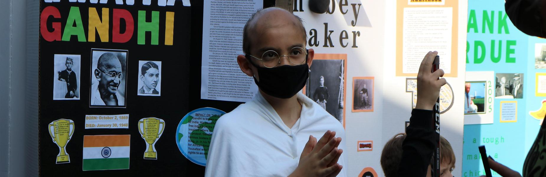 Photo of Wilson 5th grader dressed as Gandhi during Grade 5 Wax Museum.