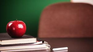 teacher's desk with books & apple