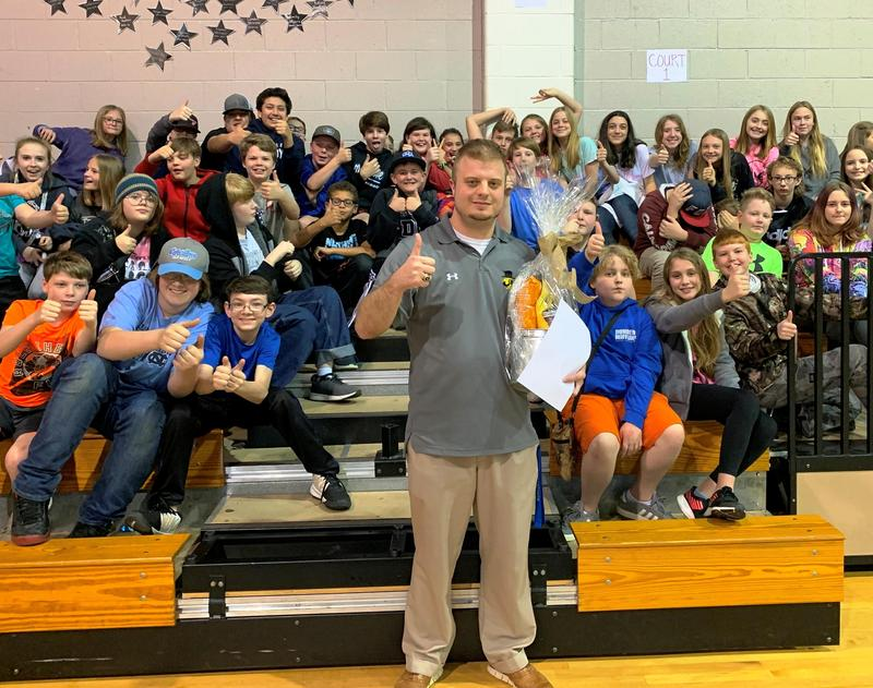 Mr. Harbour and 6th grade students
