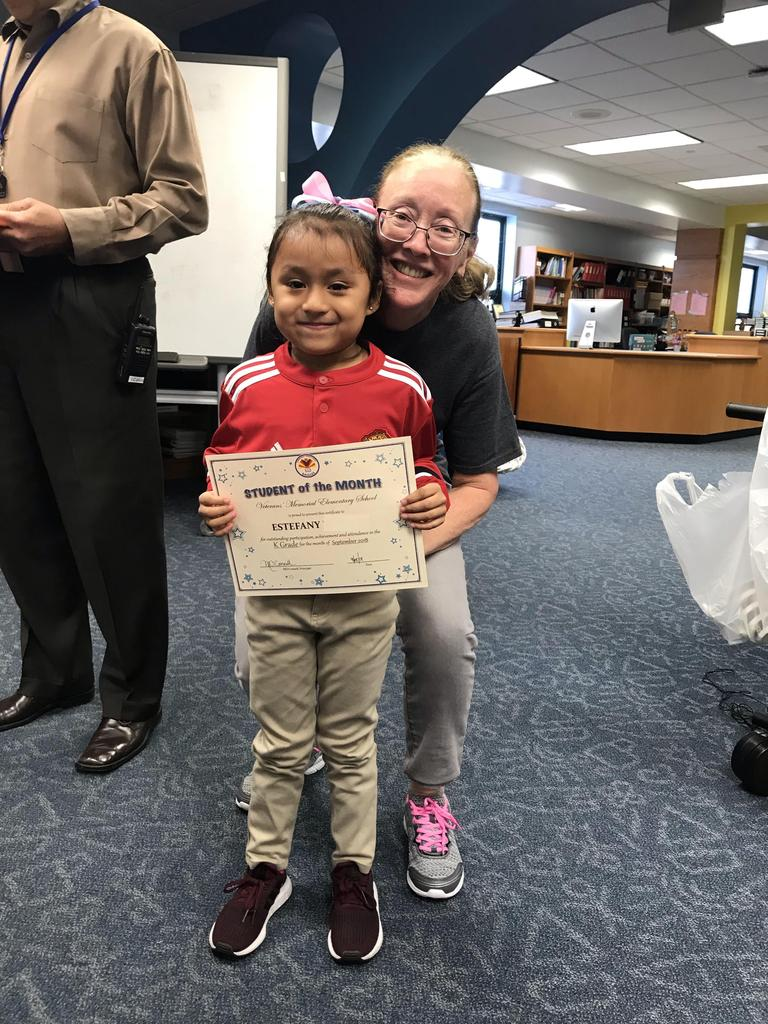 student of the month estefany kindergarten with principal O'connel