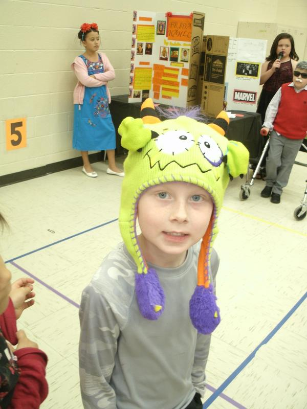 Student wearing hat on Hat Day.