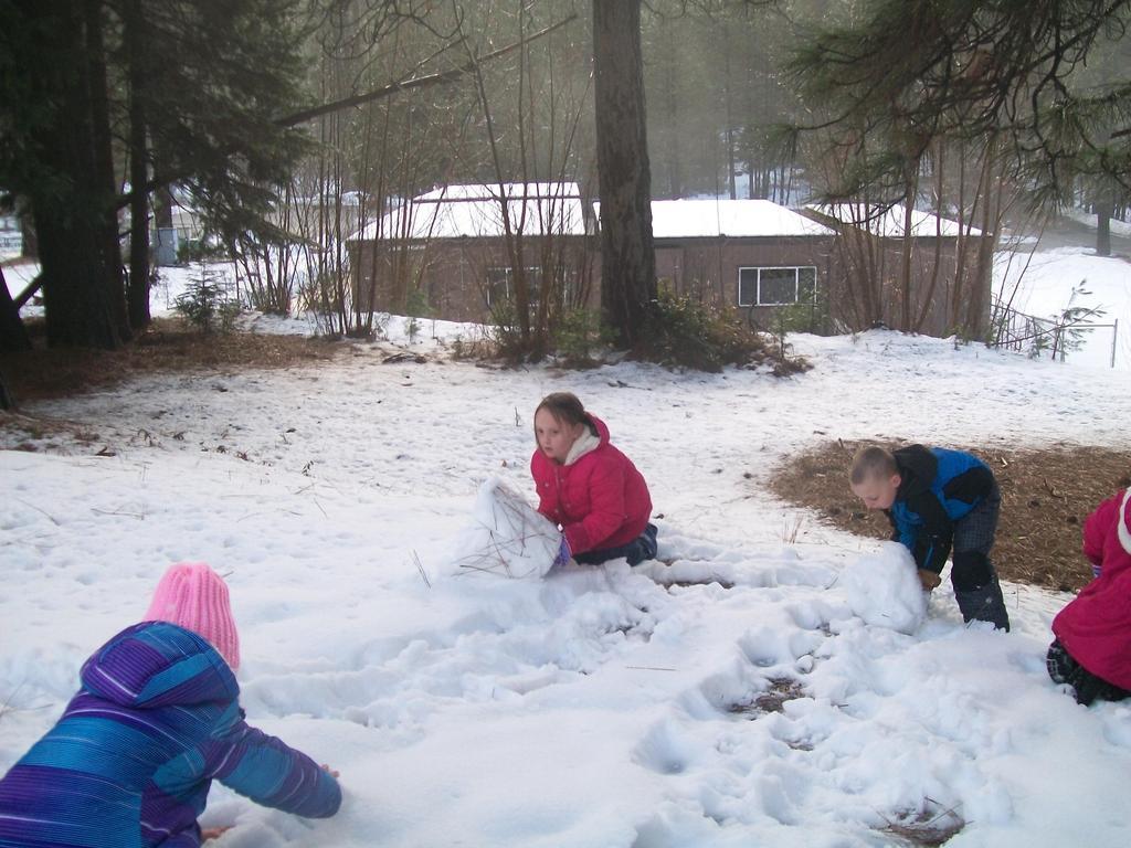 children building a snowman
