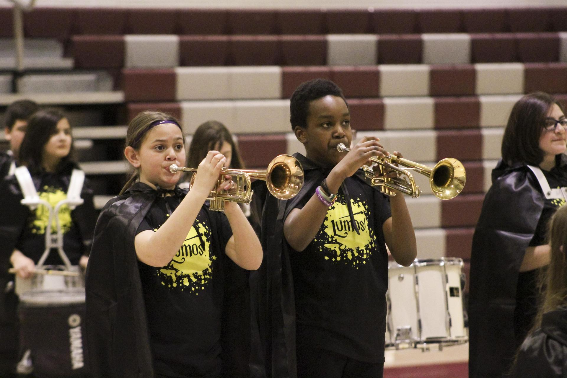 SoundSport trumpet players laying concert in high school gym