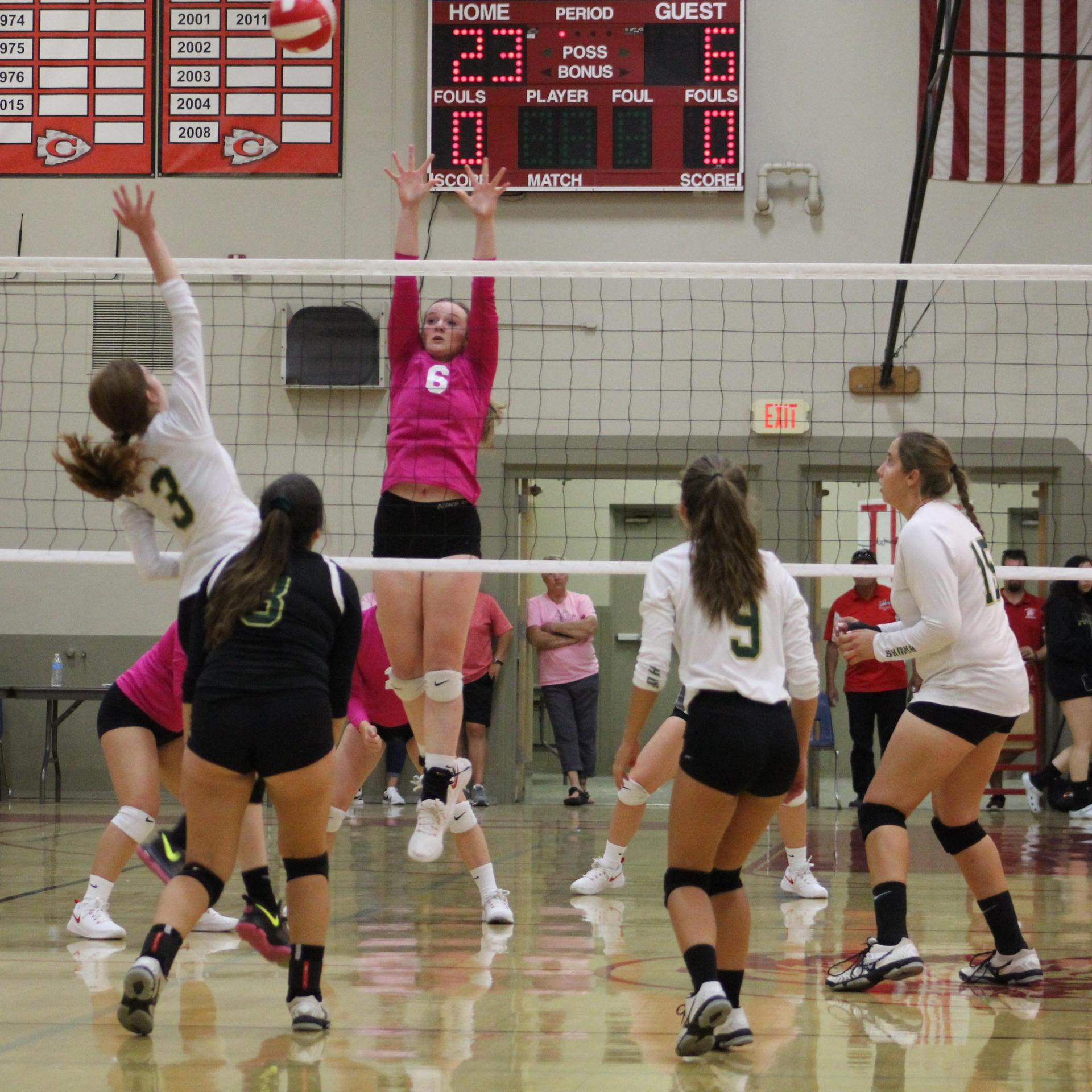 Varsity girls playing Volleyball against Liberty.
