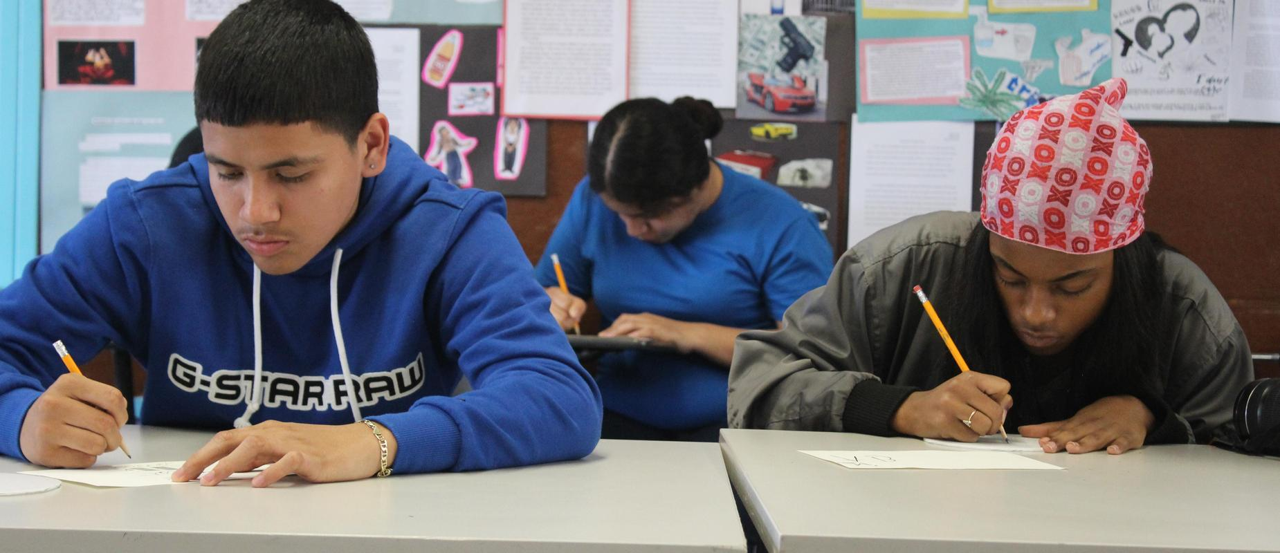 Students writing at their desks