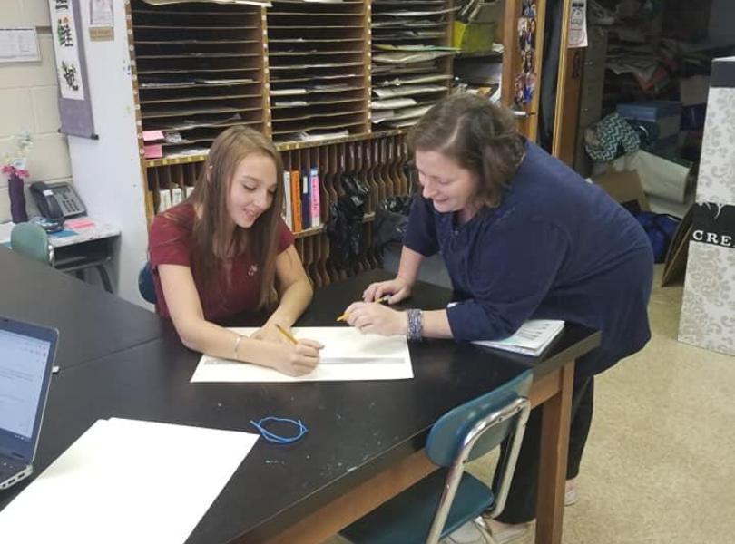 Art class - student and teacher