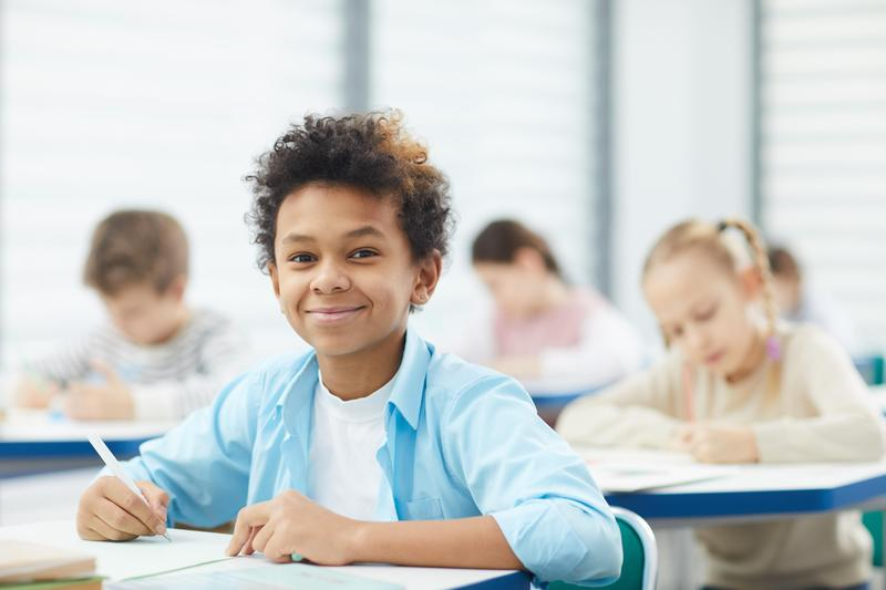 boy in classroom looking at camera