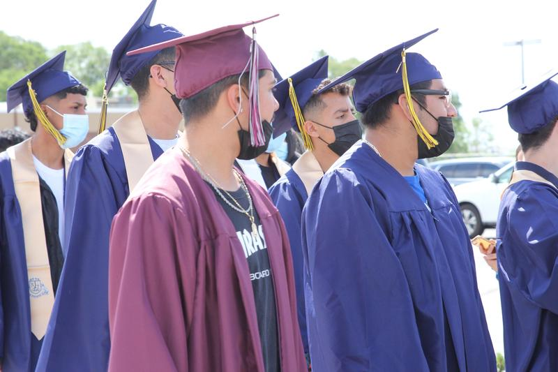 PACE and Wapato High School Graduates standing wearing caps and gowns