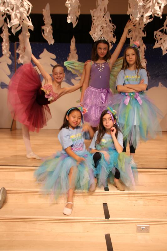 Five students dressed as ballerinas
