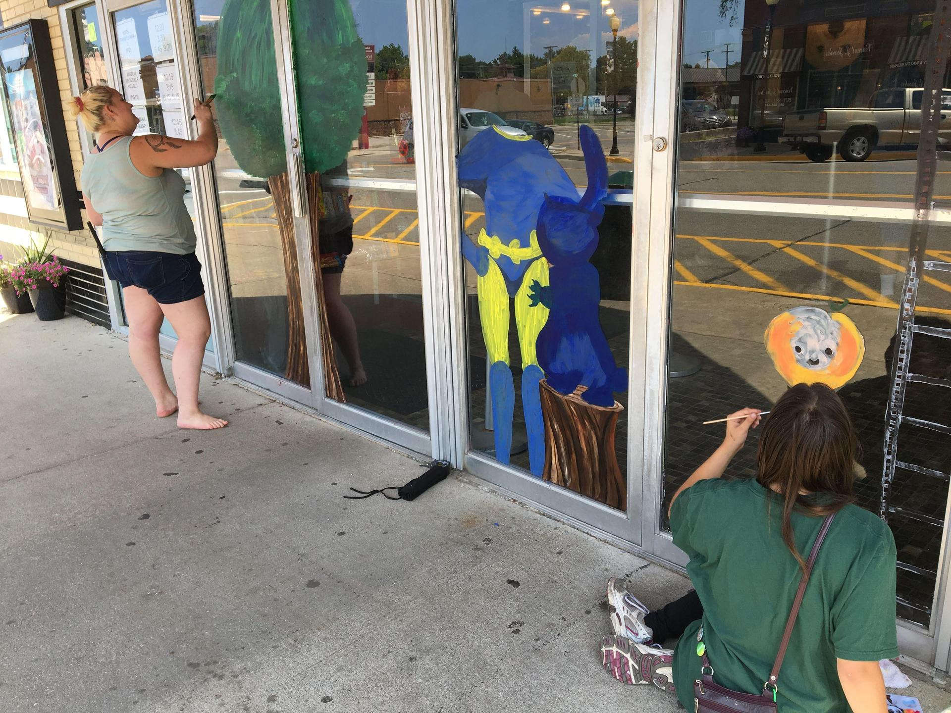 Art students volunteered their summer time to paint business windows in Coloma for the Coloma Peach Festival.
