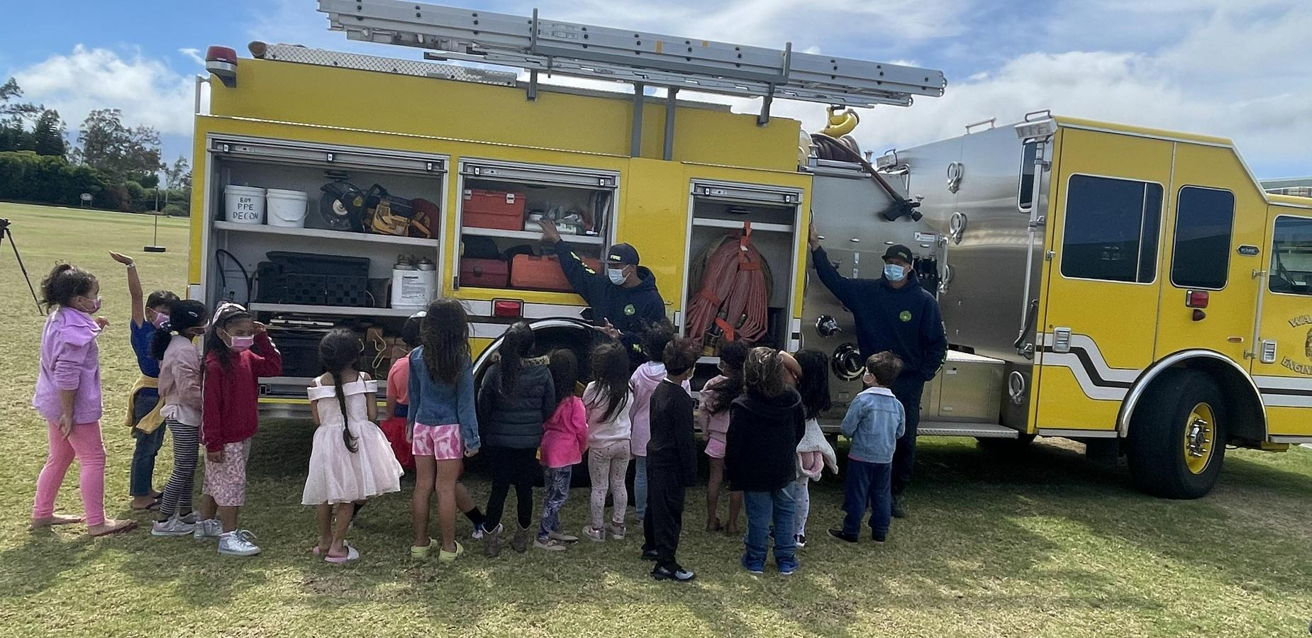 1st Graders looking at the fire engine during Fire Prevention Week