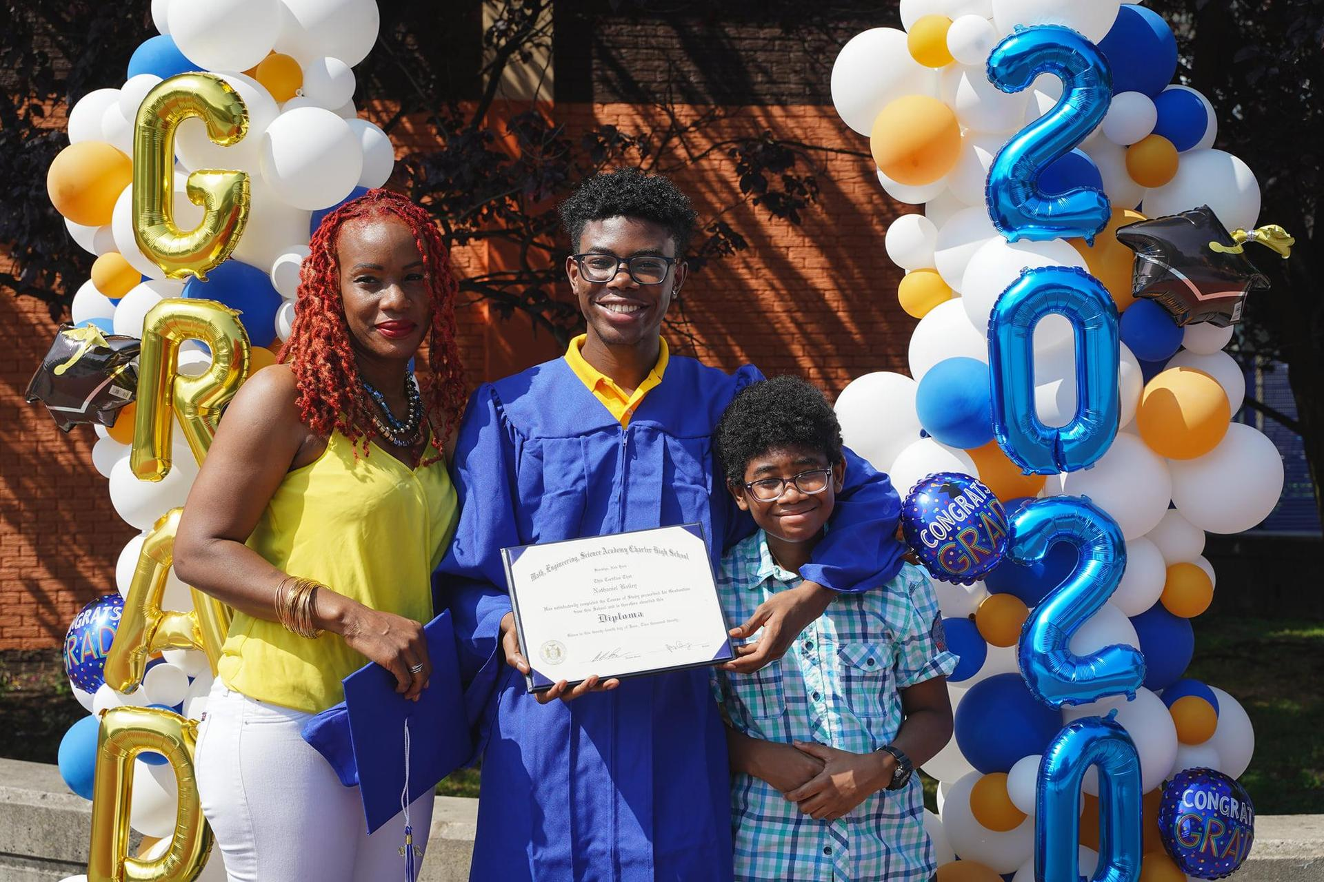 MESA graduate with family