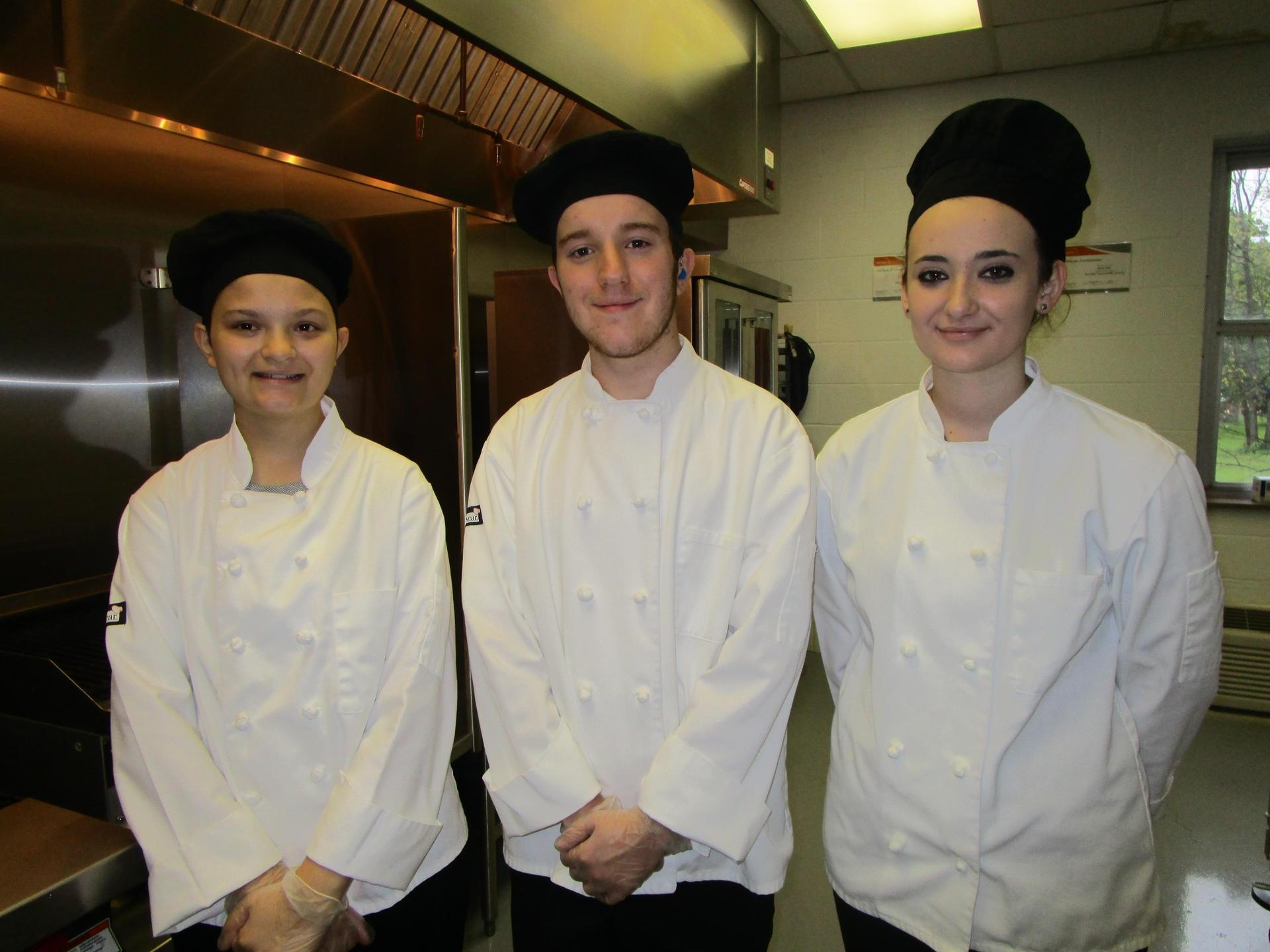 Three ProStart Students pose in their chef uniforms