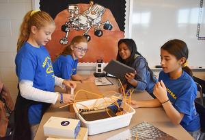 """Mars Area Centennial School students work to design and build components for  a model of a Mars rover in their STEAMclasses. The activity is part of the students' participation in NASA's """"Name the Rover Challenge."""""""