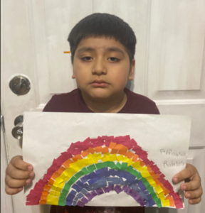 Boy holding rainbow paper mosaic