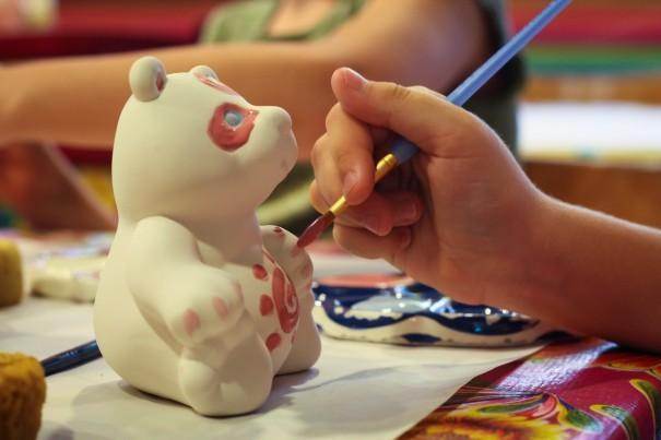 Clay bear being painted.