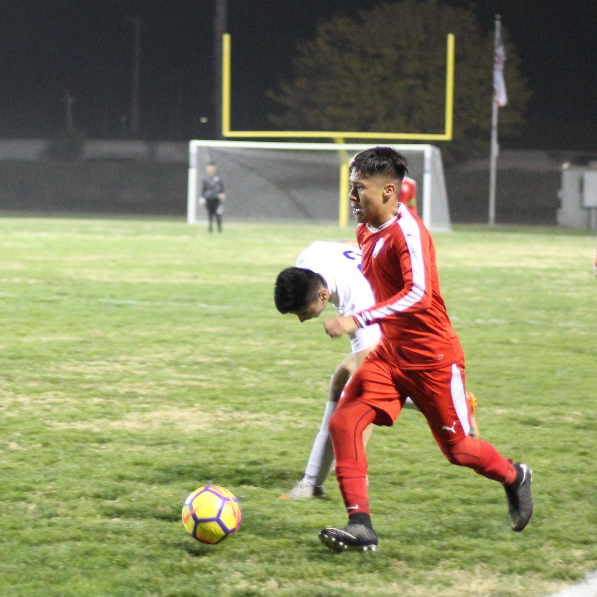 Edwin Reyes kicking the ball