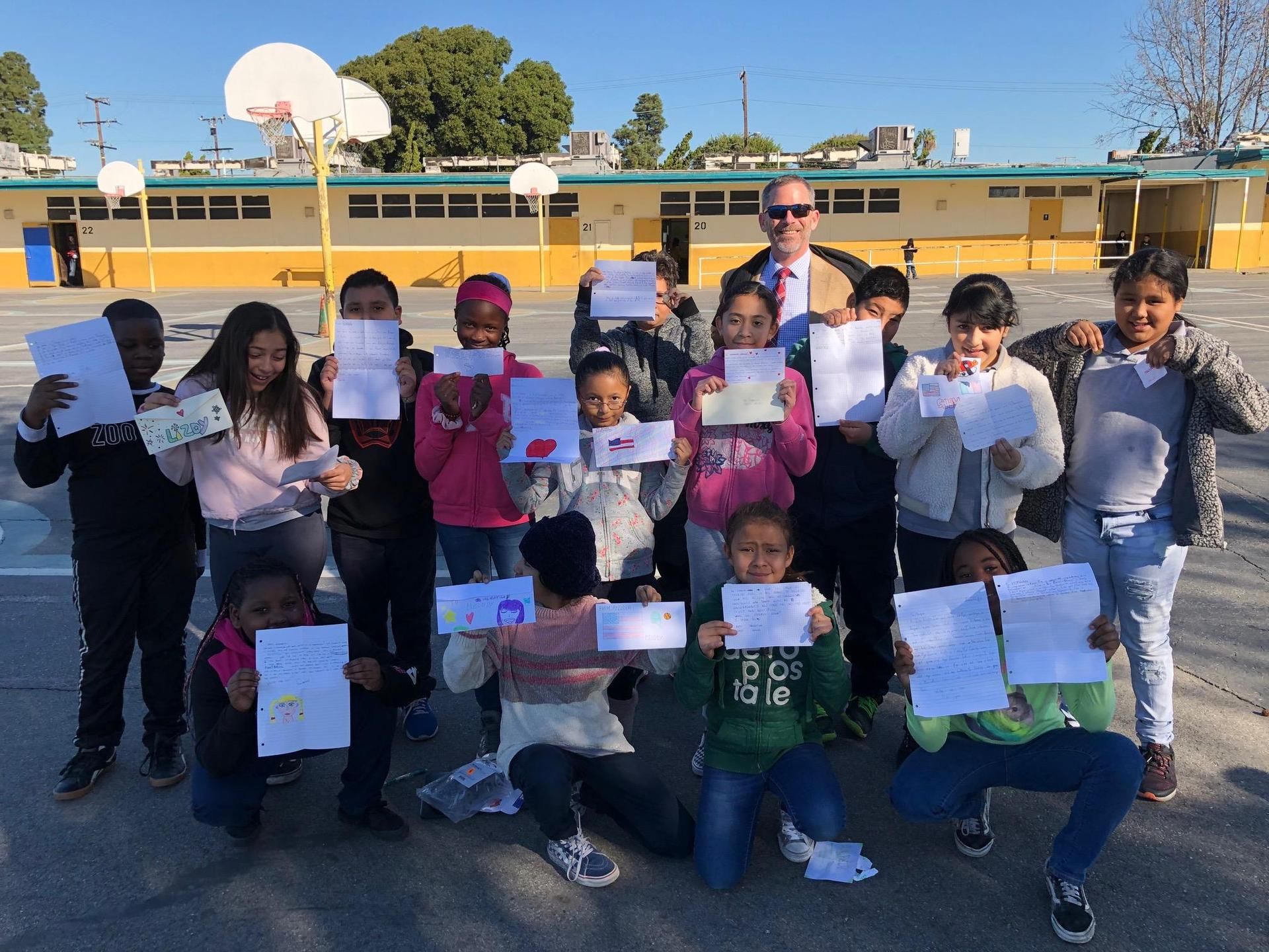 Photo of 4th graders displaying the Pen Pal Letters that they received from their Pen Pals in Italy