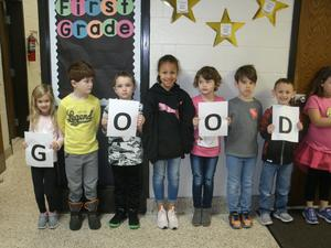 Students holding signs wishing EBOB Team good luck!