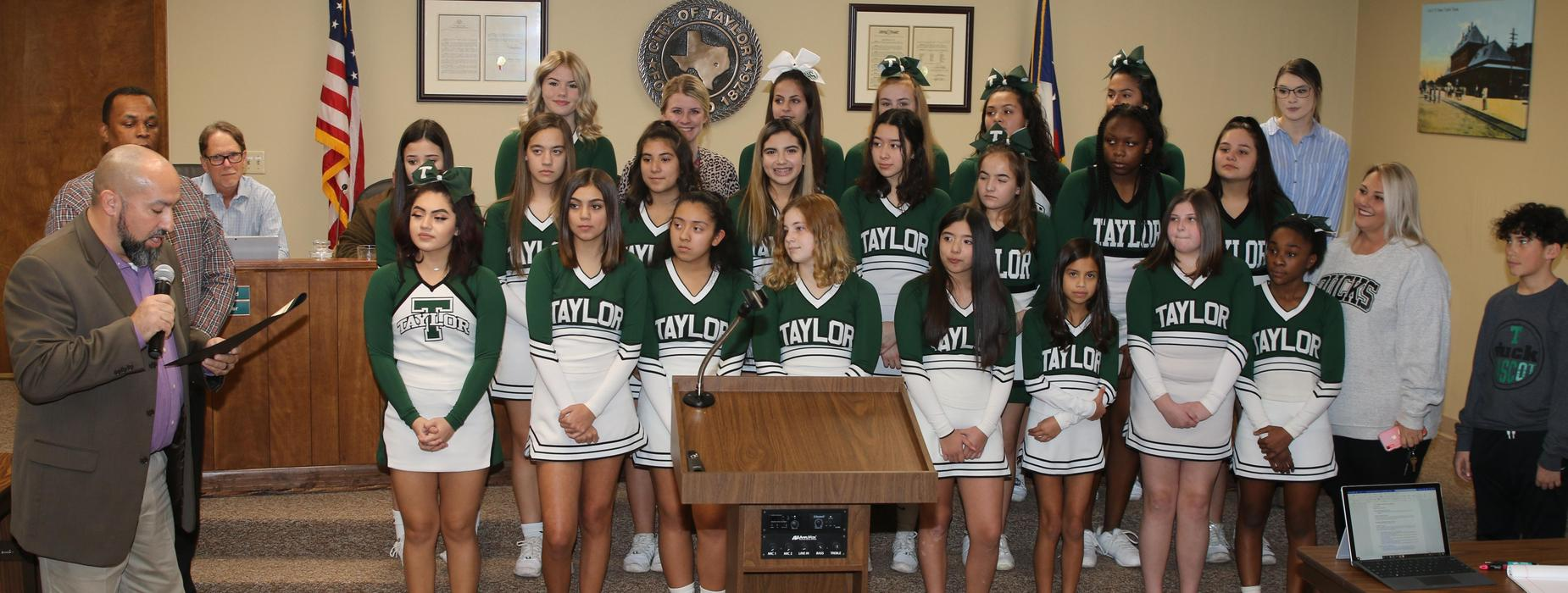 Cheerleaders at city council meeting.