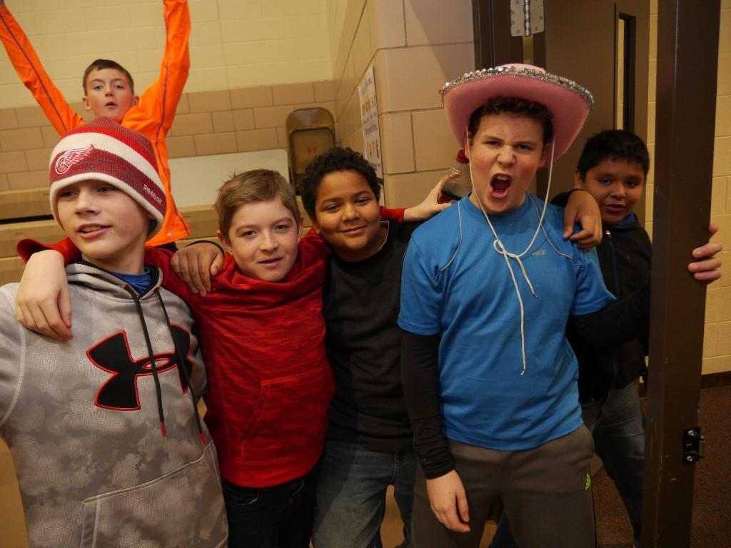students cheer in lunchroom